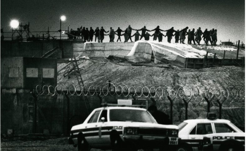 women dancing on top of the nuclear missile silos during a night time break in to the Greenham Common Nuclear Missile Base. (Provenance of photograph unestablished at time of posting - my apologies).